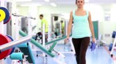 adult : Gym work out young women,Young  beauty woman exercising at a gym Stock Footage