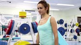 relax : Gym work out young women,Young  beauty woman exercising at a gym(side view) Stock Footage