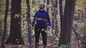 broda : Ax slowing down. Forester chopping trees in the forest. Slow motion.