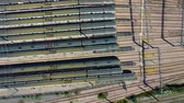депо : Aerial view over passenger trains in rows at a station Стоковые видеозаписи