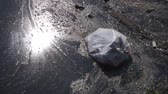 Plastic waste polluting into nature. rubbish bag floating on water Stockvideo