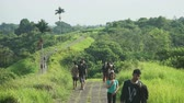 UBUD, INDONESIA - October, 2017: Girls and boys walk on Campuhan Ridge Walk Stock Footage