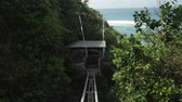 fenda : Cliff lift to Sundays beach Club from Ungasan Clifftop Resort at Bali, Indonesia Stock Footage