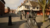 cardinal Thomas Wolsey bronze statue in Ipswich town at the junction of Silent and St Peters streets. Ancient medieval timber framed buildings . Suffolk. East England. 13 march 2016 Stock Footage