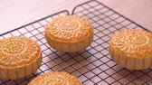 linear : Fresh baked Chinese moon cake pastry for traditional Mid-Autumn festival, close up, truck shot movement. 4K Resolution.