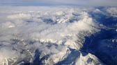 tirol : Flying over the snow covered Austrian Alps in Tirol region Stock Footage