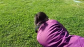 Female photographer using DSLR camera on grass, shooting dandelion Stock Footage