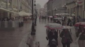 бистро : People walks on Old Arbat street during rainy summer day. Moscow downtown