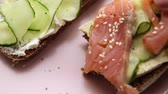 füme : Open sandwich with fish and vegetables with pink ceramic plate Selective focus