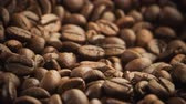 food and drink : A pile of roasted coffee beans rotating. Close up