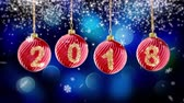 hanging 2018 number glitter Christmas balls on blue bokeh background. 3d rendering 4K Vídeos
