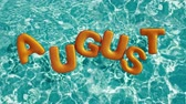 refração : word AUGUST shaped inflatable swim ring floating in a refreshing blue swimming pool, alpha 3d rendering 4K