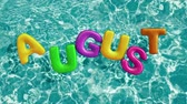 brinquedos : word AUGUST shaped inflatable swim ring floating in a refreshing blue swimming pool, alpha 3d rendering 4K