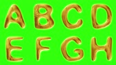 азбука : Alphabet from gold isolated on green background. The letter A B C D E F G H . alpha channel 3d rendering 4K