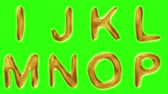 müsli : Alphabet from gold isolated on green background. The letter I J K L M N O P . alpha channel 3d rendering 4K