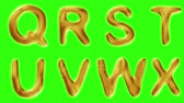 ás : Alphabet from gold isolated on green background. The letter Q R S T U V W X . alpha channel 3d rendering 4K Stock Footage