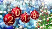 blue spot : red balls with numbers 2019 hanging on the background of a blue bokeh and a rotating Christmas tree 3d rendering. 4K