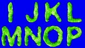 list : Alphabet from green water isolated on a blue background. The letter I J K L M N O P . alpha channel 3d rendering 4K
