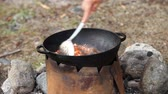plov : Cooking of meat in cauldron outdoors Stock Footage