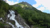 вдохновляющий : View waterfall scenes in mountains, national park Dombai, Caucasus, Russia. Summer landscape, sunshine weather, blue sky and sunny day
