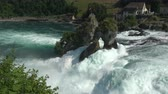 ilham verici : View waterfall the Rhine Falls (Rheinfalls) in Schaffhausen, Switzerland. The Rhine Falls is the largest waterfall in Europe. Summer landscape, sunshine weather, blue sky and sunny day
