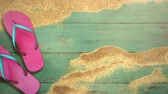 klapki : Closeup sandy beach with sandal on wood, summer background. Elegant and luxury dynamic style animation footage