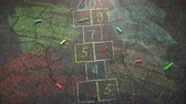 kreda : Closeup colorful chalk on street, school background. Elegant and luxury animation footage of education theme