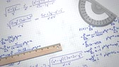Closeup mathematical formula and elements on paper, school background. Elegant and luxury animation footage of education theme Vidéos Libres De Droits