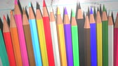 Closeup of kids background with colourful pencils, school background. Elegant and luxury animation footage of education theme