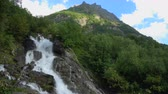 谷 : Waterfall scenes in mountains, national park of Dombay, Caucasus, Russia. Summer landscape, sunshine weather and sunny day