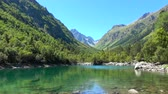 inspirar : Lake scenes in mountains, national park of Dombay, Caucasus, Russia. Summer landscape, sunshine weather, blue sky and sunny day