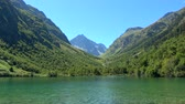 谷 : Lake scenes in mountains, national park of Dombay, Caucasus, Russia. Summer landscape, sunshine weather, blue sky and sunny day