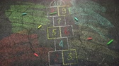 Closeup colorful chalk on street, school background. Elegant and luxury animation footage of education theme