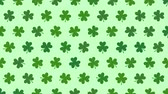 İrlanda : Animation Saint Patricks Day holiday background with motion green shamrocks. Luxury and elegant dynamic style template for holiday