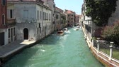Venice, Italy - July 1, 2018: Panoramic view of Venice narrow canal with historical buildings and boats traffic from Bridge Foscari on retro camera Dostupné videozáznamy