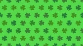 İrlanda : Motion green shamrocks, Saint Patrick Day animation background. Luxury and elegant dynamic style template for holiday Stok Video