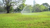 yards : Garden water sprinkler system. Stock Footage