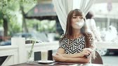 замена : young woman smoking electronic cigarette Стоковые видеозаписи
