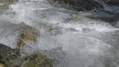 vacuity : Beautiful water in a mountain river in slow motion video. Shooting speed 180fps, slow motion. Live shooting of the most beautiful nature river mountain water. The camera is not static. Stock Footage