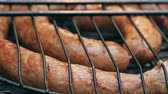 endro : Grilled sausages on bbq. Variety Original Nuremberg Rostbratwurst . Pork ground meat, dill, nutmeg, garlic, cardamom, marjoram in the natural gut. There are also other types: rostbratwurst, currywurst, bockwurst, bratwurst, thuringer rindswurst