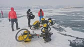 crazy : RUSSIA, OLKHON - FEBRUARY 28, 2018: Cyclists travelers from Poland ride ice on bicycles. Extremes cross Lake Baikal along its length. Route of the hike is more than 600 km. Weight of each bicycle along with the removal of more than 130 kg.
