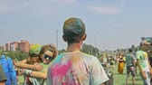 oddanost : RUSSIA, IRKUTSK - JUNE 27, 2018: Happy young people dancing and celebrating during Music and Holi Festival Of Colors. Crowd of people colored powder and having fun in arena.