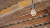 incandescente : old light bulb of Ilyich on the background of the wooden roof of the barn