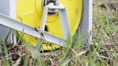 fogaskerekek : The winch pulls the cable to which the plow is attached. Plowing land on the farm. Close up