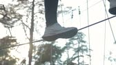 engel : Close-up of the girls feet goes and balances on the rope