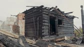 maradványok : The ruins of an old wooden house destroyed by fire. Steadicam shot