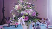 vazo : Stylish and rich design and decor of the festive table with dishes and flowers in lilac tones for a wedding or other celebration