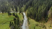 vadi : Shooting from above a beautiful river in a mountain valley Stok Video