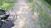 bir parçası : POV slow-motion shot of a rider in a crash helmet and part of a black motard motorcycle, Enduro racing through the woods during the race. Extreme entertainment on rough terrain. The concept of active recreation Stok Video