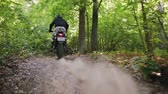 tory : Steadicam shot a rider in protective gear on a motorcycle off-road modification, famously passing through a dense forest with natural jumps. The concept of active recreation
